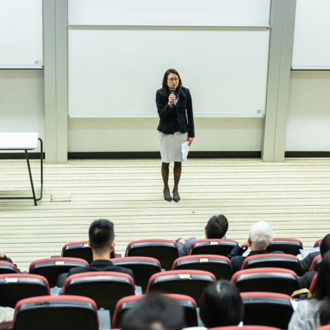 woman lecturing in auditorium